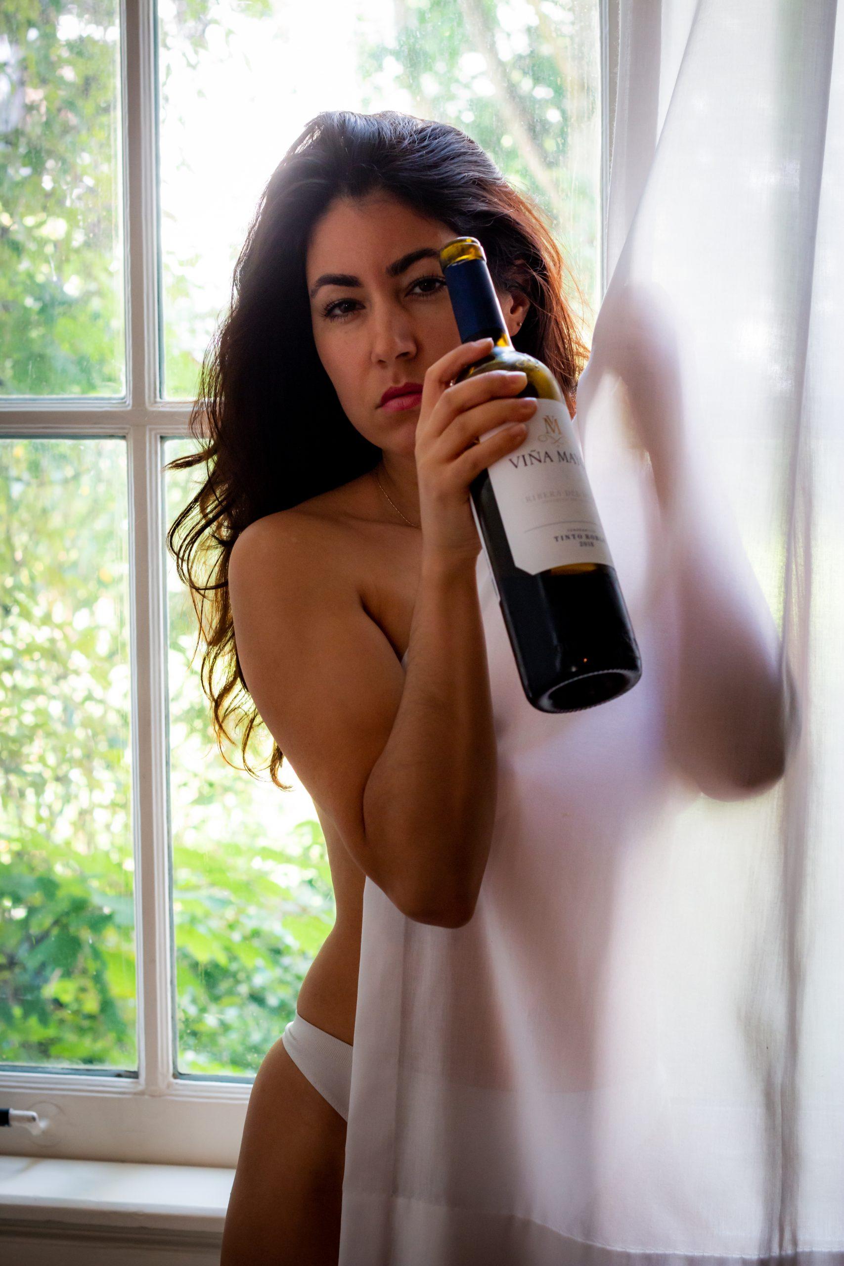 wine behind curtains